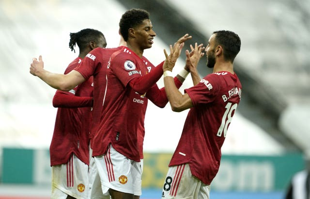 Marcus Rashford, centre, celebrates his goal at Newcastle