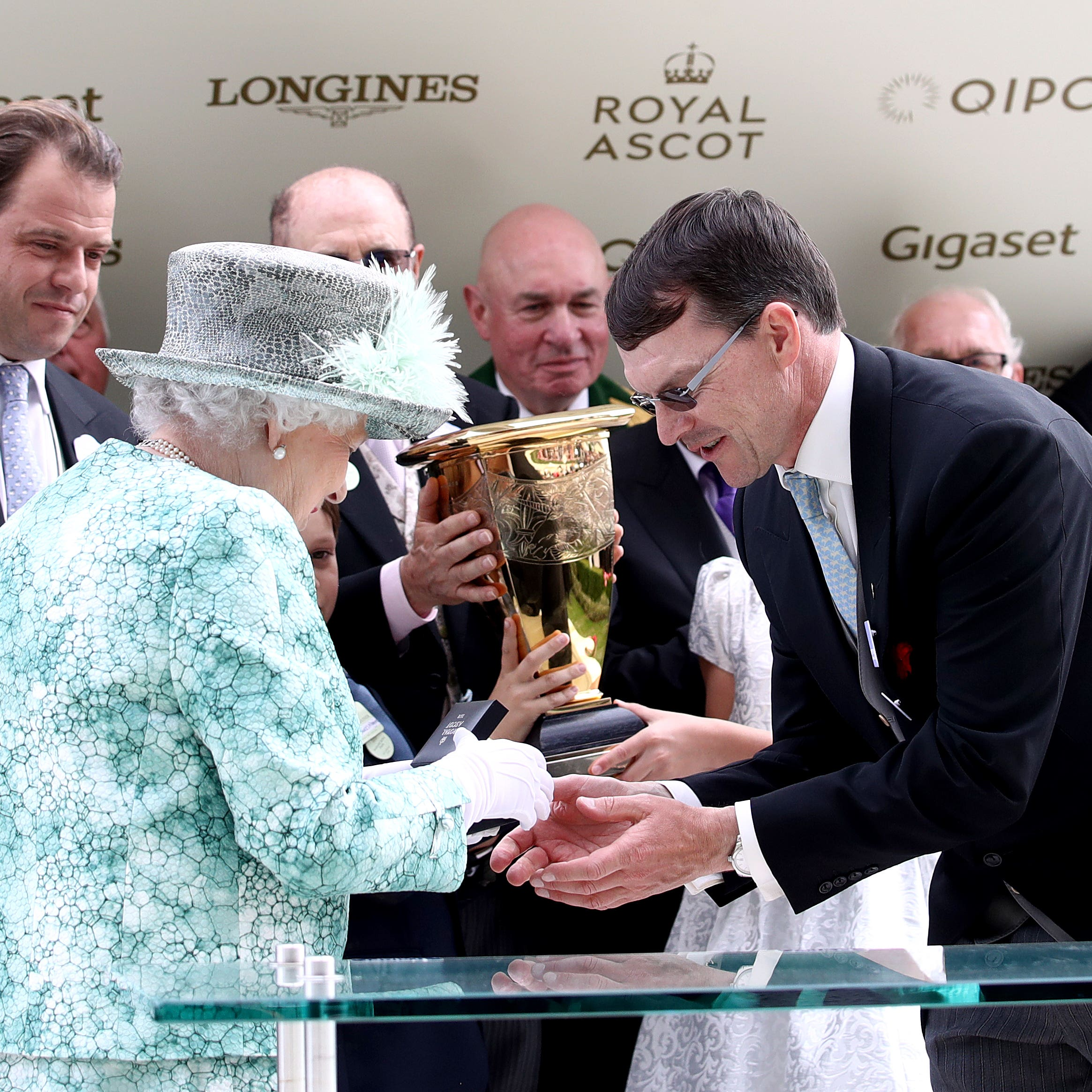 The Queen presents a momento to Aidan O'Brien after Merchant Navy wins the Diamond Jubilee Stakes