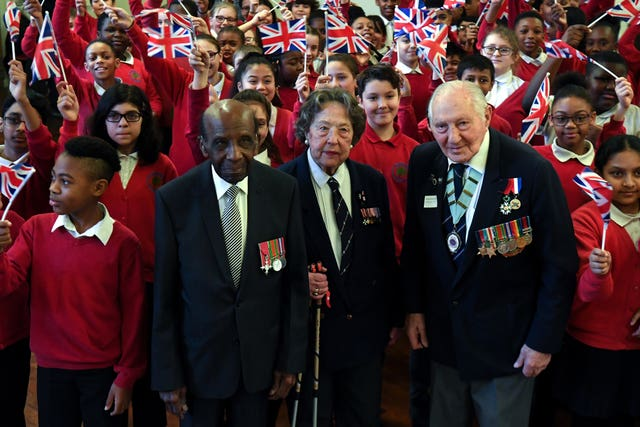 Veterans Mervyn Kerch, 95, Marzena Schejbal, 95, and Neil Flanigan, 96, with pupils at Sandhurst Primary School in south east London (Kirsty O'Connor/PA)