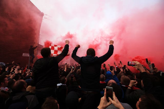 Fans let off flares before Liverpool's match against Manchester City earlier this year