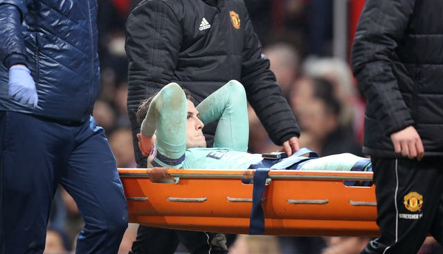 Rob Holding was taken off on a stretcher in Arsenal's draw at Manchester United on Wednesday