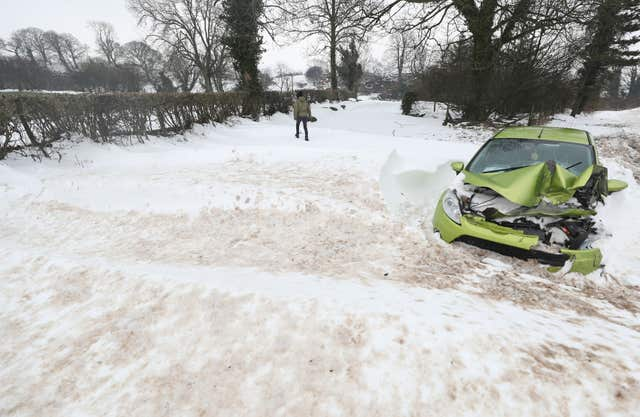 An abandoned car at Belah bridge in Cumbria (Owen Humphreys/PA)