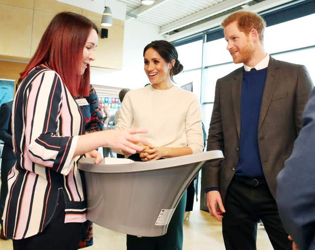 Sinead Murphy from Shnuggle baby products talks to Harry and Ms Markle (Niall Carson/PA)