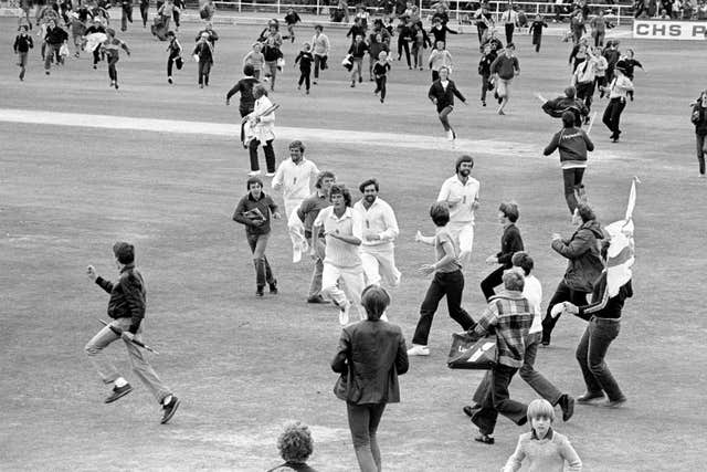 Willis (centre) leading the side off after England's sensational victory over Australia in the Third Cornhill Test of The Ashes at Headingley as fans run on to celebrate