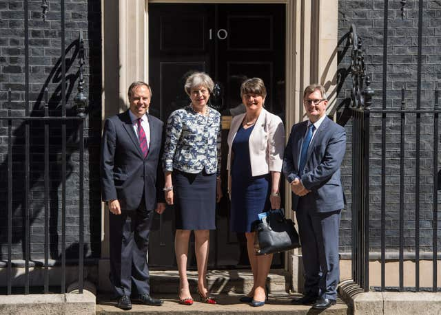 Theresa May with DUP leader Arlene Foster, deputy leader Nigel Dodds and MP Sir Jeffrey Donaldson outside 10 Downing Street ahead of talks aimed at finalising a deal to prop up the minority Conservative Government