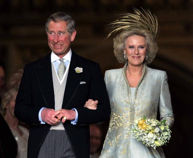 The Prince of Wales and his bride the Duchess of Cornwall leave St George's Chapel in Windsor after their blessing (PA)