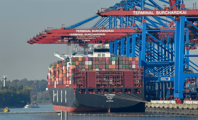 A container ship is loaded at the harbour in Hamburg, Germany