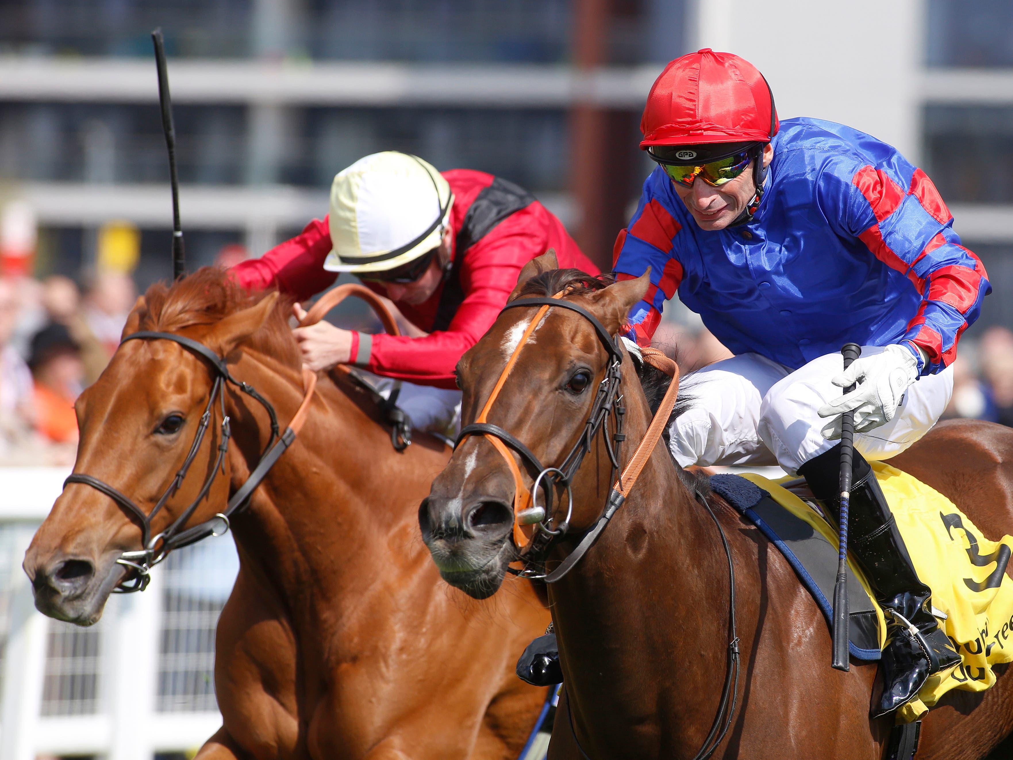Dandhu (red cap) secured her Guineas ticket in winning at Newbury (Julian Herbert/PA)