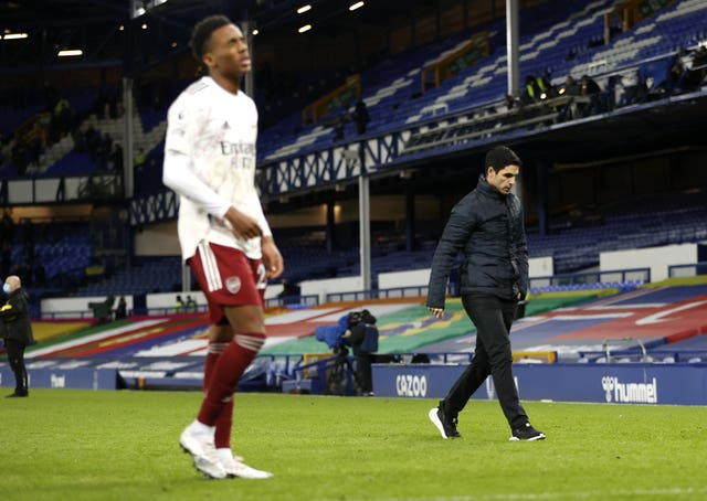 Mikel Arteta, right, leaves the field after defeat to Everton