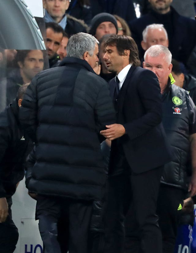 Manchester United boss Jose Mourinho and Chelsea head coach Antonio Conte exchange words at the final whistle