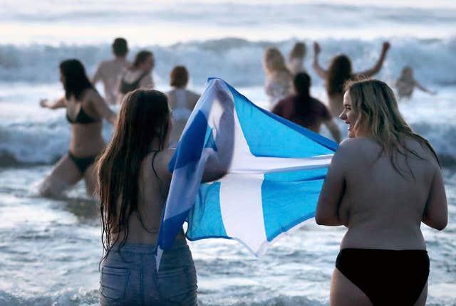 Patriotic Scots brave the elements (Jane Barlow/PA)