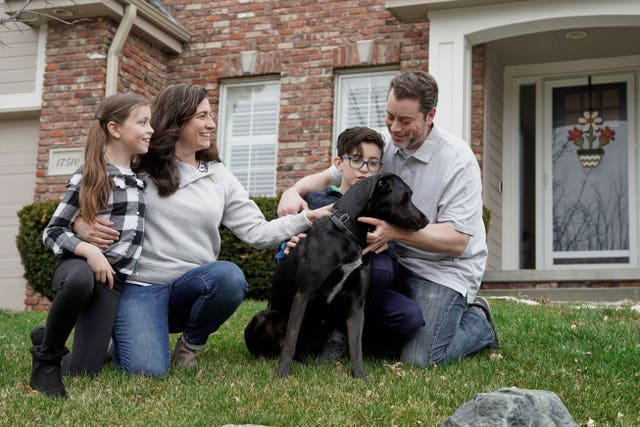 Kim Simeon, her husband, Adam and children, Annabel, nine, and Brennan, 11, with Nala, a dog they are fostering, in Omaha, Nebraska