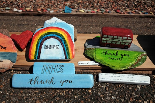 Tributes to NHS staff and bus drivers on display at Folly House Beach on the Isle of Dogs, east London