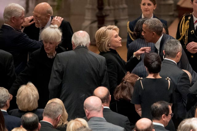 Hillary Clinton greets Barack Obama