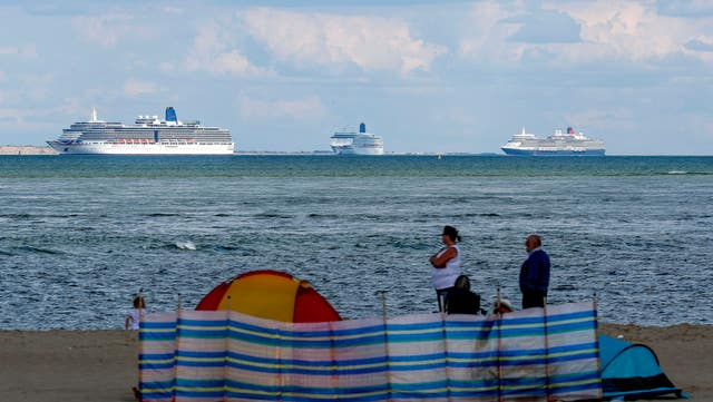 A view of the cruise ships from Studland beach (Steve Parsons/PA)