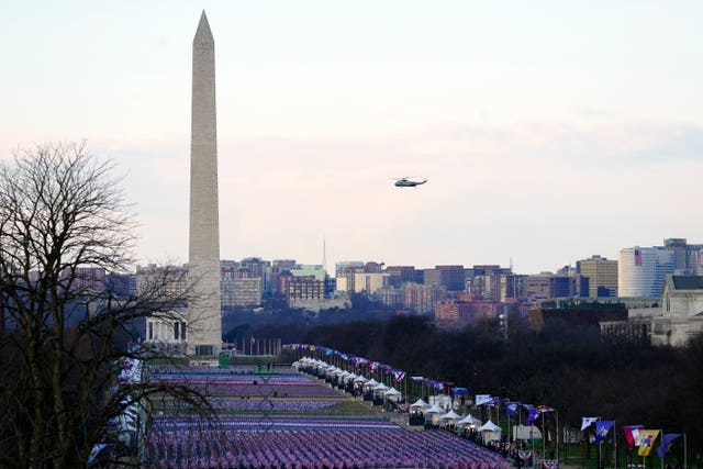 Marine One carrying President Donald Trump flies over Washington as he leaves the White House ahead of the 59th presidential inauguration for Joe Biden