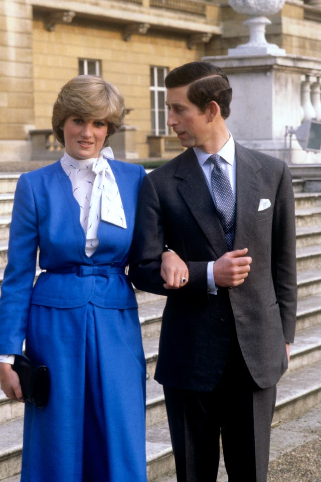 Prince Charles and Lady Diana Spencer (wearing the diamond and sapphire engagement ring he gave her) looking affectionate in the grounds of Buckingham Palace after the announcement of their engagement in London on Feb. 24, 1981.