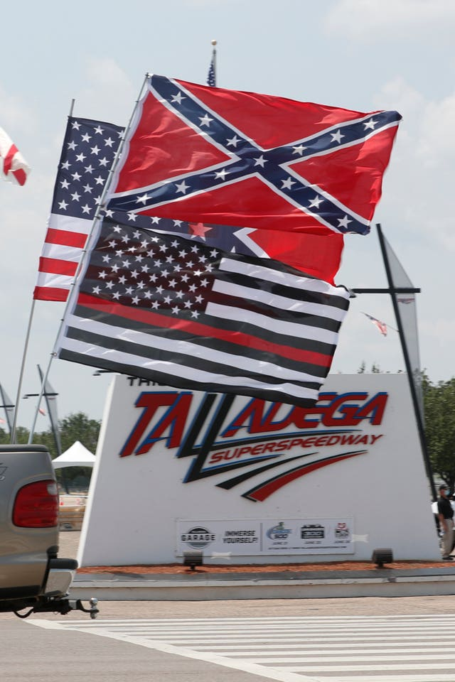 Race fans fly Confederate battle flags and United States flags (John Bazemore/AP)
