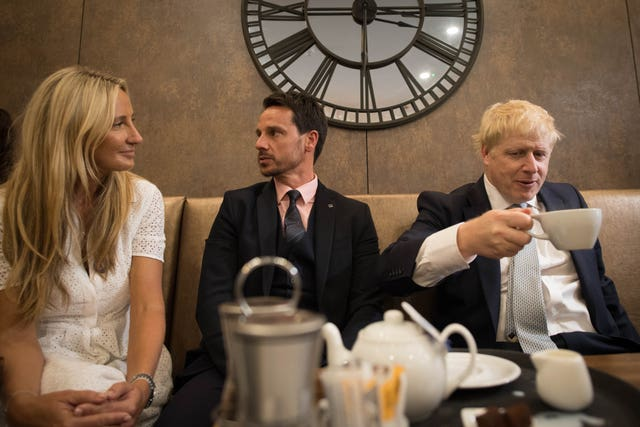 Mr Johnson interacts with local business people
