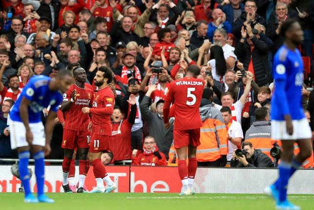 Sadio Mane, second left, is congratulated by Mohamed Salah after opening the scoring