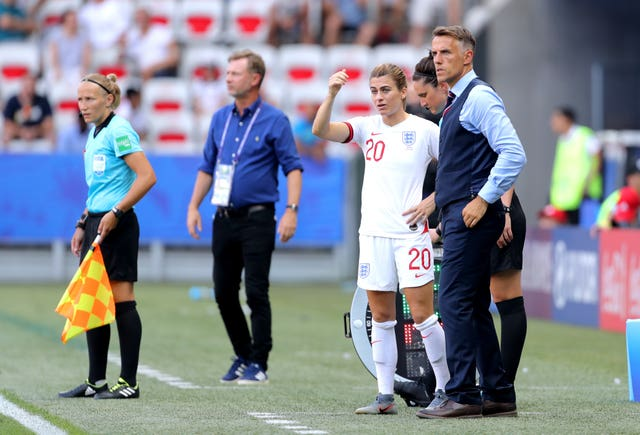 Phil Neville, right, will stand down from leading England when his contract expires in July 2021 (Richard Sellers/PA)