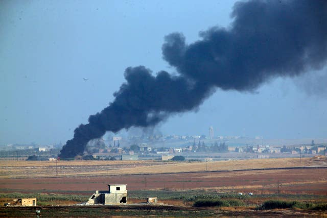 Smoke billows in Syria during bombardment by Turkish forces
