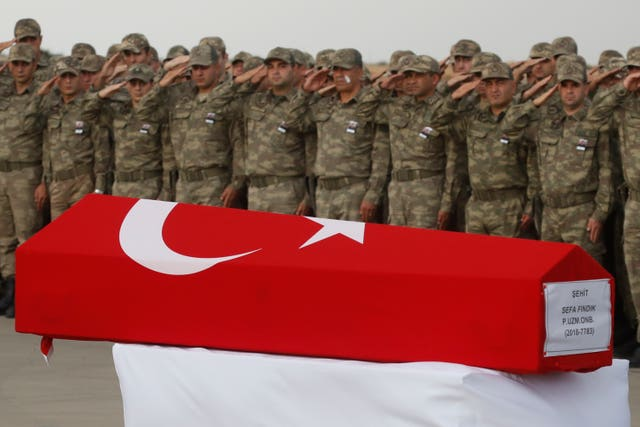 The Turkish flag-draped coffin of a soldier killed in action in Syria