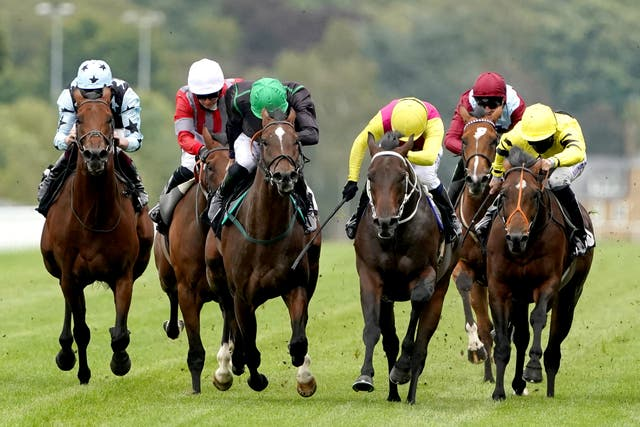 George Scott (white cap) in action at Ascot