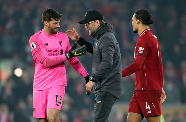 Liverpool are looking to tie Alisson, left, and Virgil Van Dijk, right, down to new contracts