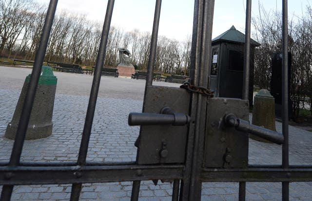 A chain secures the gates to Warsaw's popular Lazienki Park