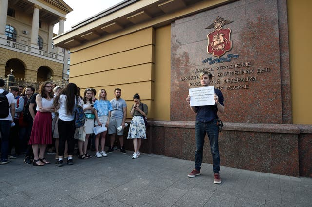 Colleagues and friends  mount a picket protest for detained journalist Ivan Golunov at the Russian Internal Ministry building in Moscow