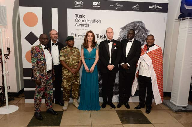 The Duke and Duchess of Cambridge stand for a photograph with guests at the Tusk Conservation Awards