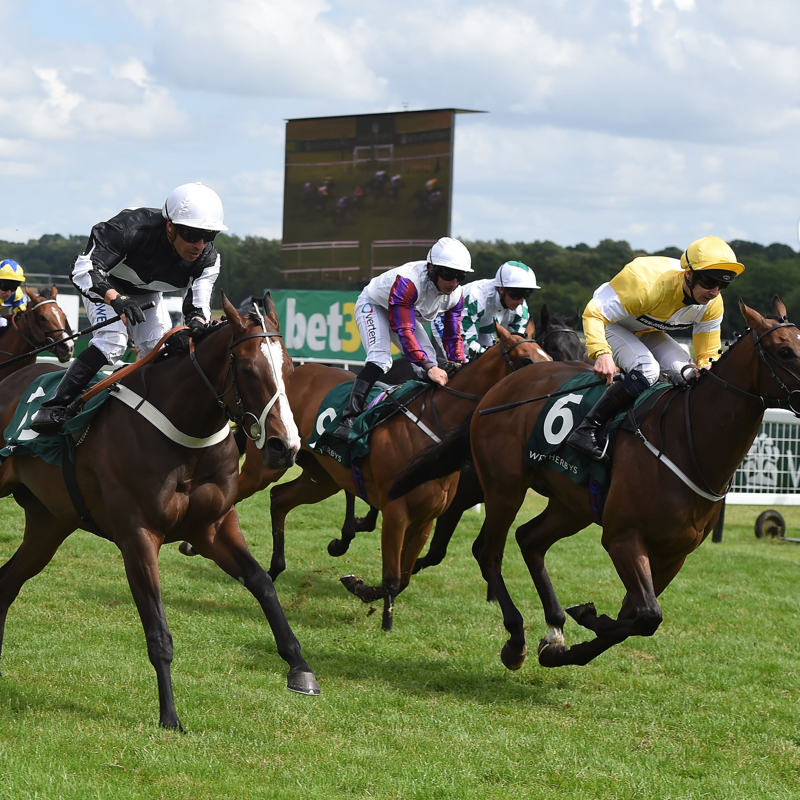 Silvestre de Sousa (near side) gets up close home to claim the Weatherbys Super Sprint at Newbury