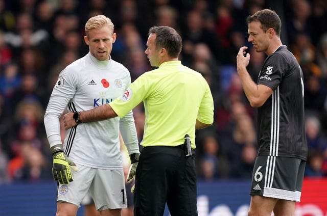 Kasper Schmeichel (left) had objects thrown in his direction