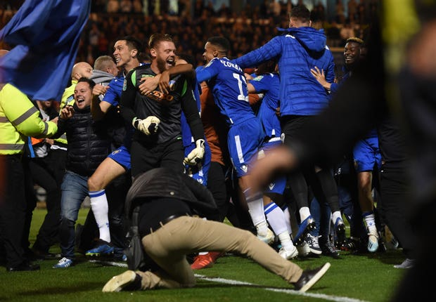 Colchester fans invade the pitch after their victory