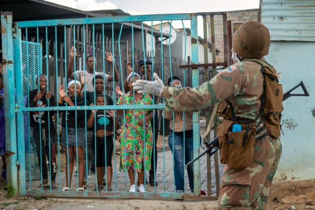 South African National Defence Forces patrol the densely populated Alexandra township east of Johannesburg