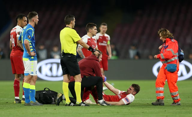 Aaron Ramsey receives treatment after picking up an injury