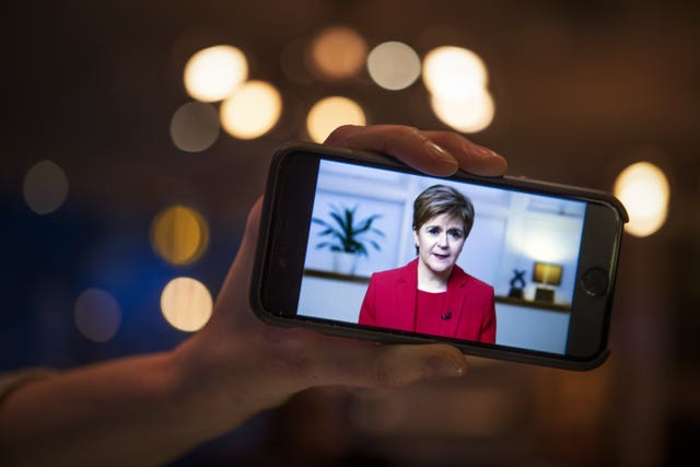 Sturgeon speech at SNP conference on a phone