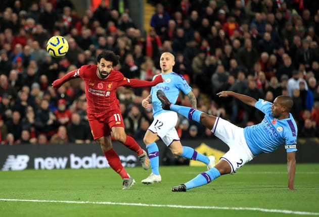 Liverpool's Mohamed Salah (left) scores his side's second goal of their 3-1 victory against Manchester City