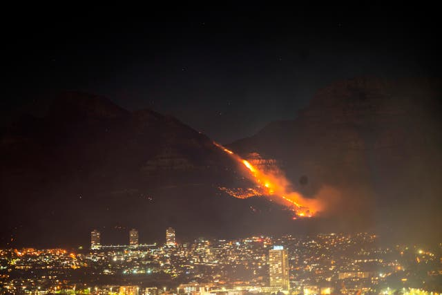Residential neighbourhoods are lit by raging fires in Cape Town, South Africa