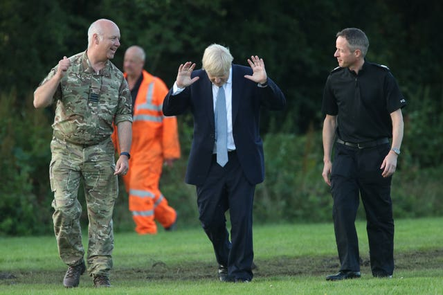 Mr Johnson arrives to meet emergency crews during a visit to Whaley Bridge Football Club (Yui Mok/PA)