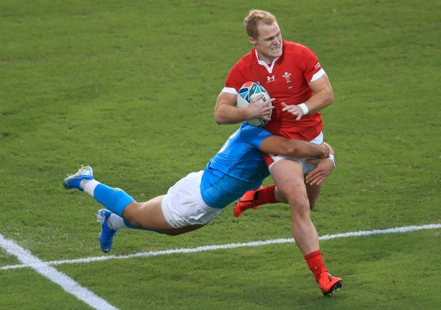 Wales overcame Uruguay to progress to the quarter-finals as pool winners
