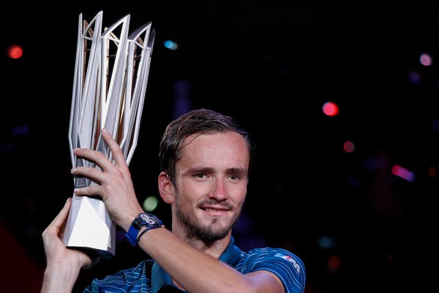Daniil Medvedev holds aloft his trophy from the Shanghai Masters