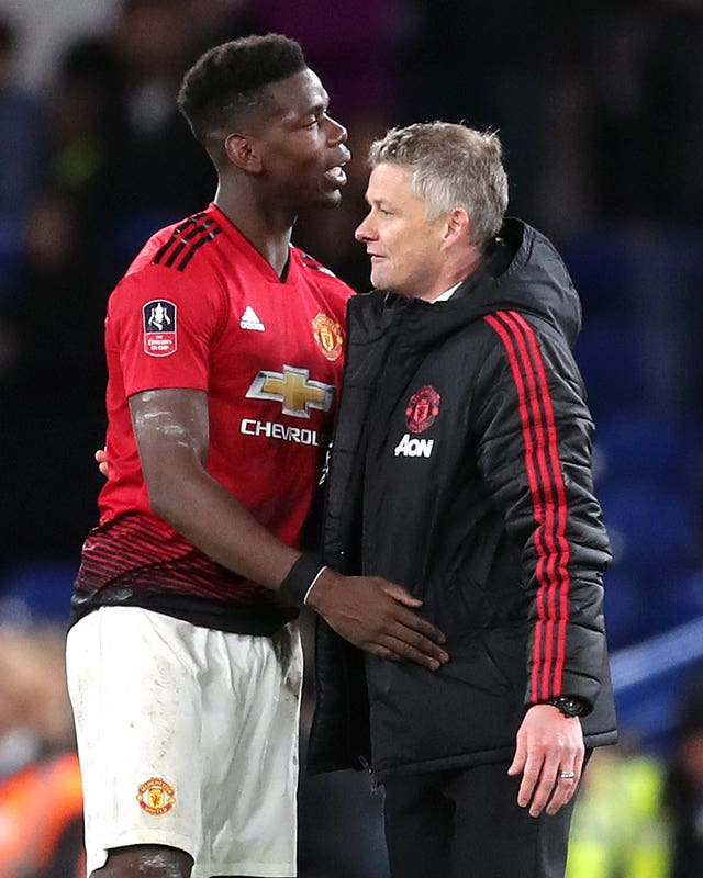 Paul Pogba, left, with Ole Gunnar Solskjaer
