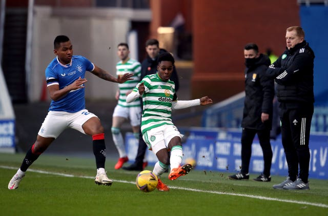 Alfredo Morelos, left, and Jeremie Frimpong battle for the ball