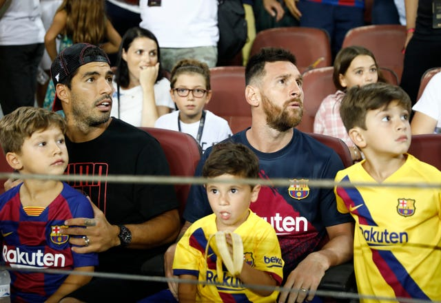 Lionel Messi and Luis Suarez were keen spectators in the stands