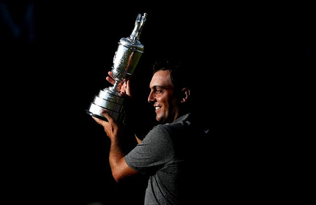 Italy's Francesco Molinari lifts The Open's Claret Jug after winning at Carnoustie in 2018. Molinari played a key role in Europe's Ryder Cup win later that year, becoming the first player to win five matches. He partnered Tommy Fleetwood in the fourballs and foursomes. He also won the European Tour's Race to Dubai title
