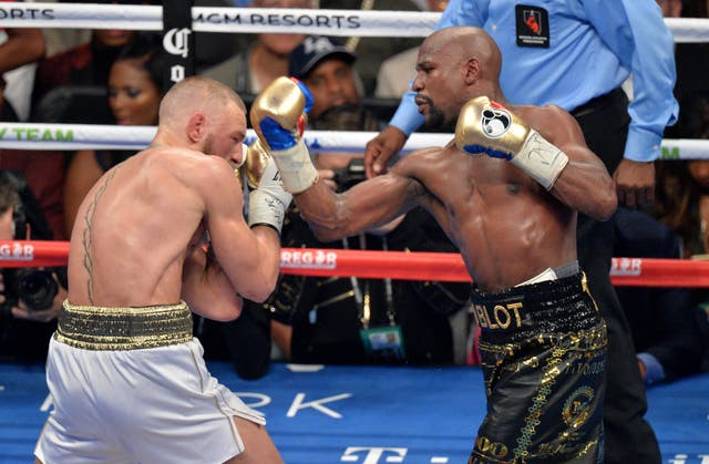 Floyd Mayweather, right, beat Conor McGregor to extend his perfect professional record to 50-0 (PA)