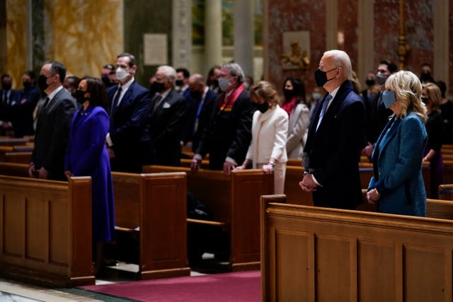 President-elect Joe Biden and his wife Jill Biden attend Mass at the Cathedral of St Matthew the Apostle during Inauguration Day ceremonies in Washington, with vice president-elect Kamala Harris and her husband Doug Emhoff to the left
