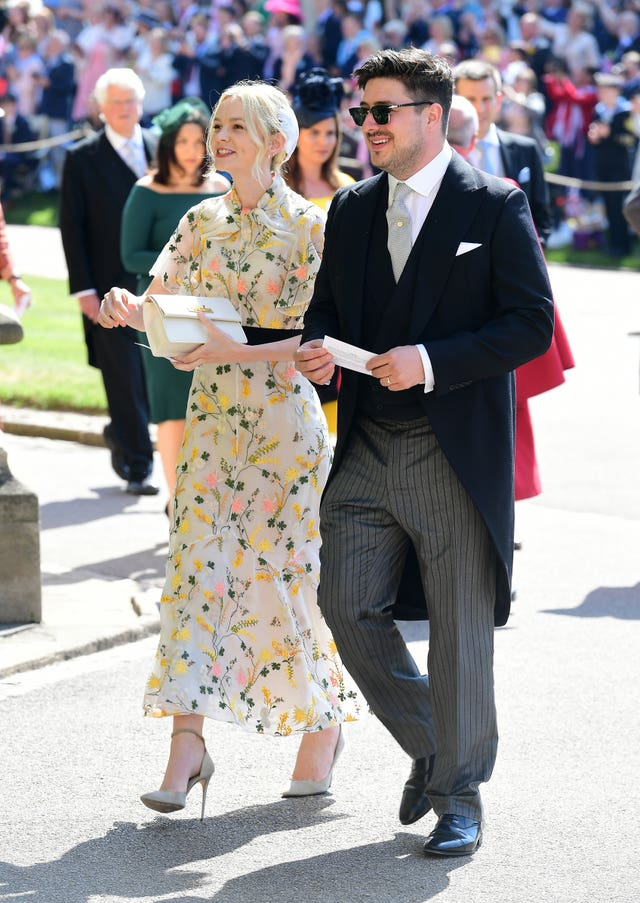 Marcus Mumford and Carey Mulligan arrive at St George's Chapel (Ian West/PA)